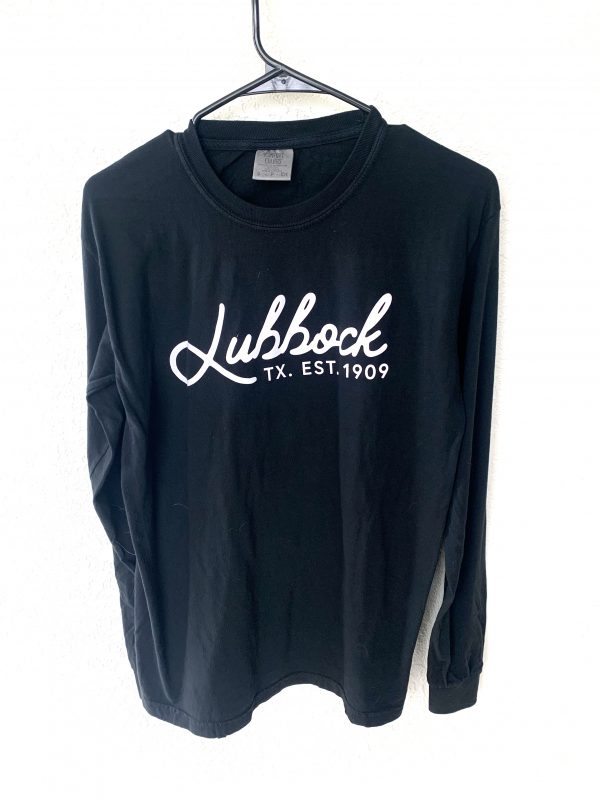 A photograph of an LBK 1909 long-sleeve hanging against a plain background